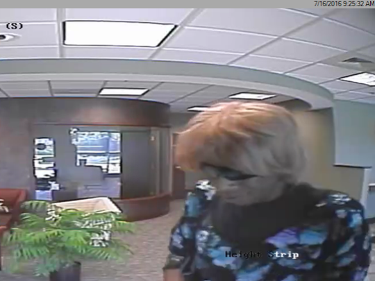 Eric Reaves, 47, of York, is seen in this surveillance photo from July 16, 2016, robbing York Traditions Bank on St. Charles Way in York Township. He pleaded guilty on  Monday to four counts of robbery in exchange for a sentence of five to 10 years in prison.