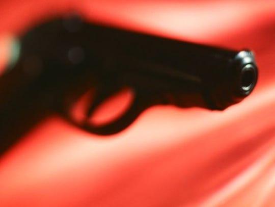 Shooting gun.
