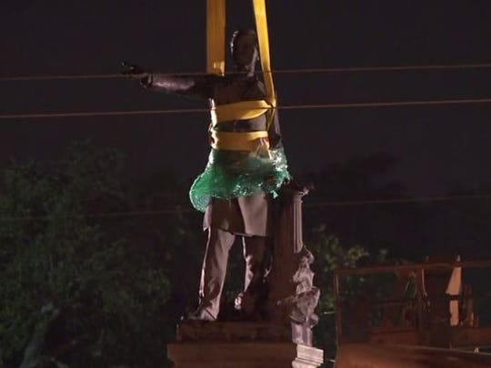 A monument in New Orleans to former Confederate president Jefferson Davis was removed Thursday, May 11, 2017, during the early morning hours. Here, the monument is wrapped in bubble wrap before its removal.