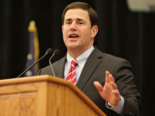 Gov. Doug Ducey plans to keep nearly $14,000 in donations