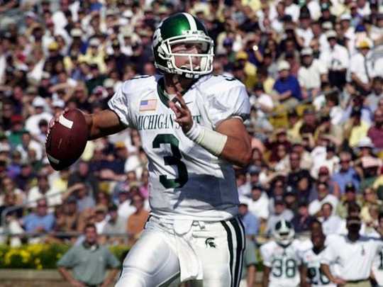 MSU quarterback Ryan Van Dyke looks for a receiver in a 2001 matchup against Notre Dame.