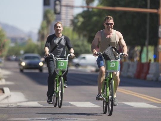 Residents take a spin on rental bikes as part of a regional sharing program in the Phoenix area.