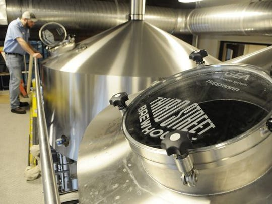 A brewer oversees the tanks at Third Street Brewhouse in Cold Spring. The brewery was awarded two silver medals at the 2019 Best of Craft Beer Awards competition held last weekend in Bend, Oregon.