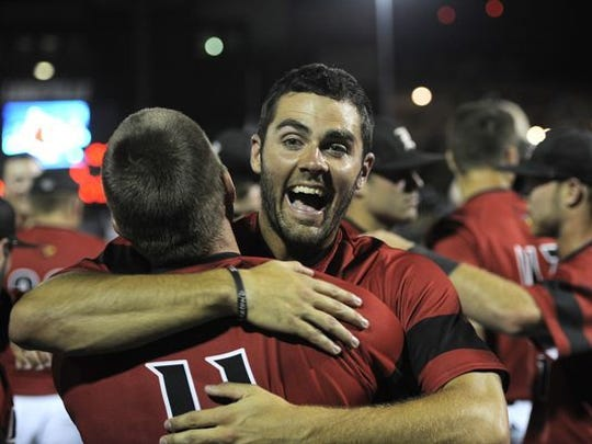 Louisville's Jeff Gardner (right) hugs teammate Zach Lucas as the Cardinals celebrate their win over Kennesaw State during the 2014 Louisville Super Regional at Jim Patterson Stadium.