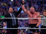 Paul Heyman and Brock Lesnar.