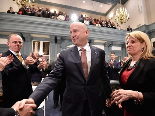 Former Delaware Gov. Jack Markell stands next to House Majority Leader Valerie Longhurst.