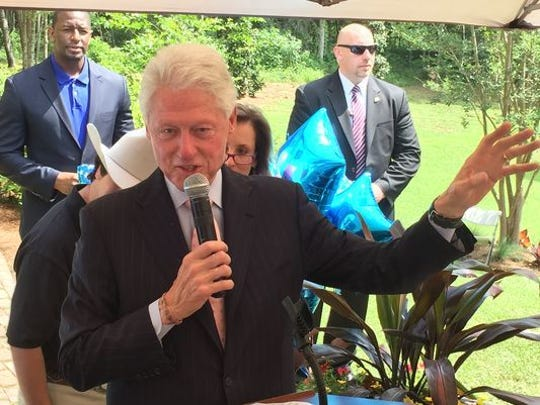 Former president Bill Clinton speaks at a Tallahassee, Fla., fundraiser on April 29, 2016. Behind him, in a blue jacket, is Tallahassee Mayor Andrew Gillum, who played a key role in Hillary Clinton's presidential campaign, working on policy positions and mobilizing young Democratic elected officials. The event was held at the home of Allison Tant, then-chairwoman of the Florida Democratic Party.
