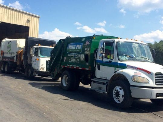 While phone apps abound, Waste Pro says it has not seen one that would work well for pinpointing trash pickup times.