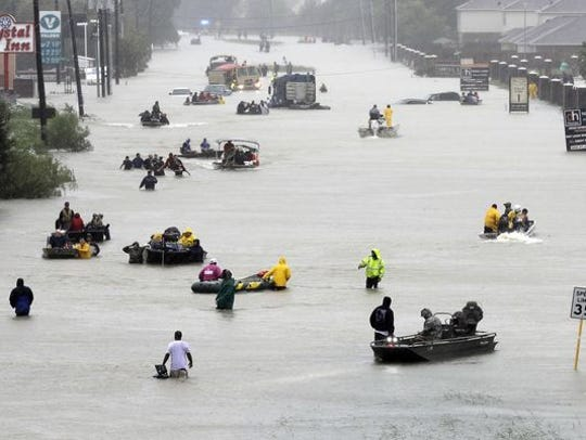 Rescue boats fill a flooded street from Tropical Storm