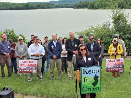 Julia Somers, Executive Director of Boonton-based New Jersey Highlands Coalition, introduces speakers during a Open Space and Water Resource Protection Rally, June 7, 2017 Spruce Run Reservoir, Clinton, NJ