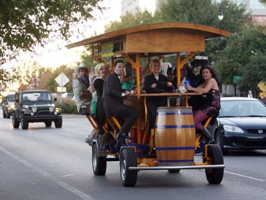 Riders on the Nashville Pedal Tavern. A similar tour called Pedal Pub now operates in Cape Coral and is coming to Fort Myers.