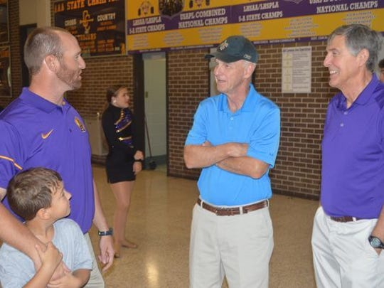 ASH coach Thomas Bachman talks with former Town Talk sports writer Bob Tompkins and Kent Roberts.