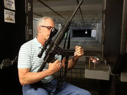 In this Caller-Times file photo Tom Whitehurst Jr. demonstrates how quickly he can fire off several rounds with his AR-15. The demonstration was part of a column he wrote on guns.
