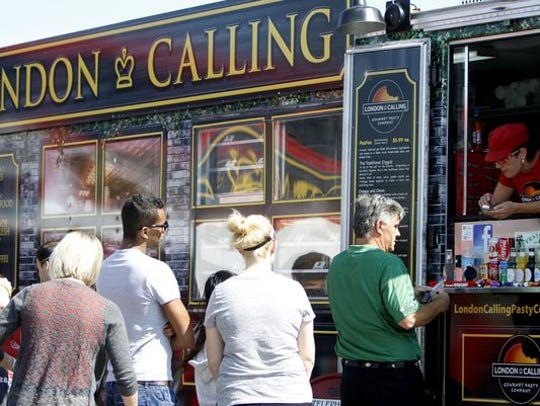 People wait in line for London Calling during lunch hour at its SGF Mobile Food Park location. London Calling will be at Battlefield Mall's Food Truck Mini Series on Aug. 18.