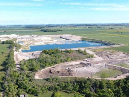 Dumping of spent lime sludge in a quarry in Benton Township has led to an ongoing legal battle.