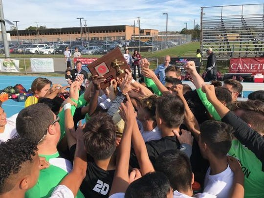 Clifton players holding up the Mustangs' 20th Passaic