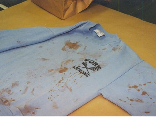 The sweatshirt that Zachary was wearing when police arrived at the scene was entered at trial as evidence.