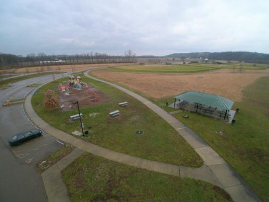 A drone's-eye view of Heritage Park in western Colerain Township. Officials are considering placing a dog park at the park on East Miami River Road along the Great Miami River.