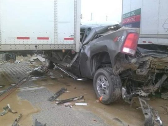 A pickup truck was crushed by semis during a huge wreck in Nevada that was caused by a sand storm in June 2013.