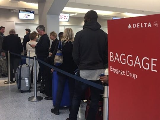 Passengers stand in line at Dallas/Fort Worth International