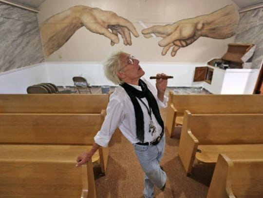 Bill Levin poses in the sanctuary at The First Church