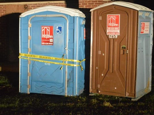 Wilmington police seal off a Kirkwood Park portable toilet where a woman was found stabbed to death. The homicide is Wilmington's 27th of the year