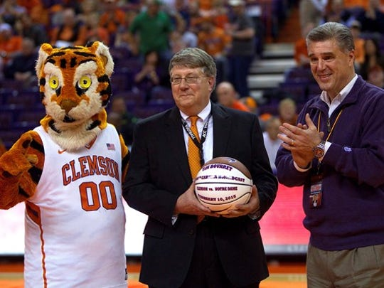 Clemson's Tim Bourret is honored prior to calling his 1,000th career basketball game on the radio in 2015.