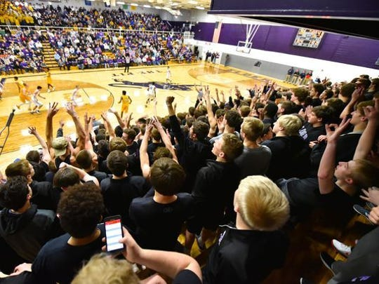 The Elder student section celebrates a 3-pointer.