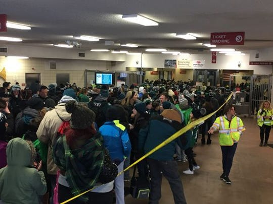 Eagles fans wait in line at PATCO's Woodcrest station on Thursday morning.