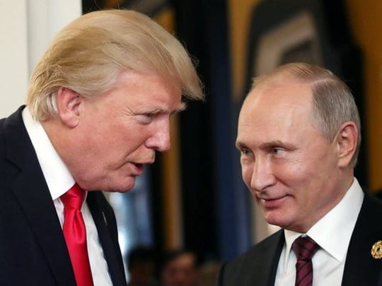 Russian President Vladimir Putin and President Trump talk at the break of a leader's meeting at the 25th Asia-Pacific Economic Cooperation ) summit in Da Nang, Vietnam, Nov.11, 2017.