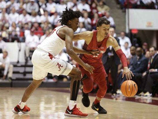 Alabama guard Herbert Jones plays defense against Oklahoma guard Trae Young during the first half at Coleman Coliseum.
