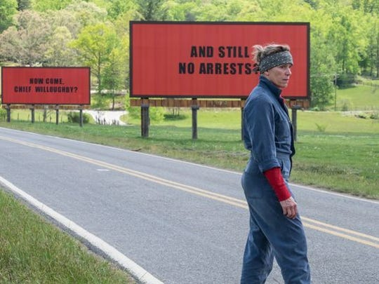 "Actress Frances McDormand walks in front of the billboards from ""Three Billboards Outside Ebbing, Missouri"" during shooting. An Arden man used the plywood from the billboards to build a carport roof in Tennessee."