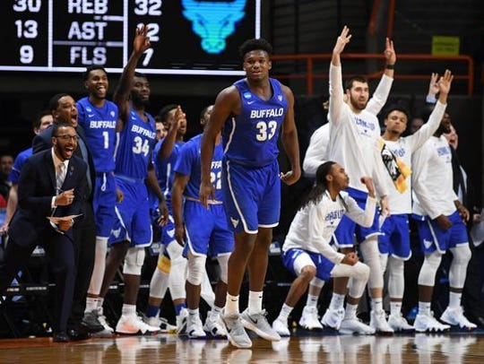 Buffalo players celebrate their first-round upset victory