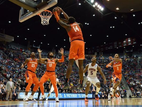 Clemson's Elijah Thomas dunks in the Tigers' 31-point victory against Auburn Sunday evening in the NCAA Tournament's Midwest Regional in San Diego.