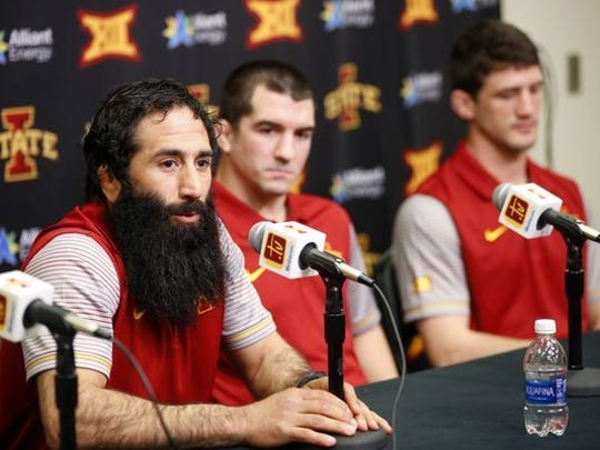 Mike Zadick (left) has been an assistant at Iowa, Virginia