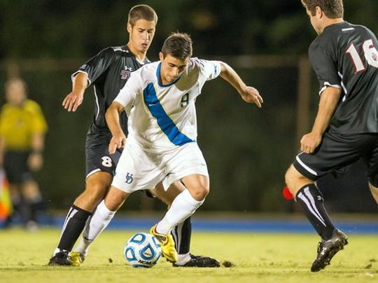 Delaware's Guillermo Delgado (No. 9) looks to cut past Fordham's Andrew Hickey (No. 4) in the second half of Delaware's 1-0 win over Fordham at Grant Stadium at the University of Delaware in 2017.
