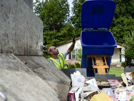 636590423168218529-Recycling-curbie-worker.jpg