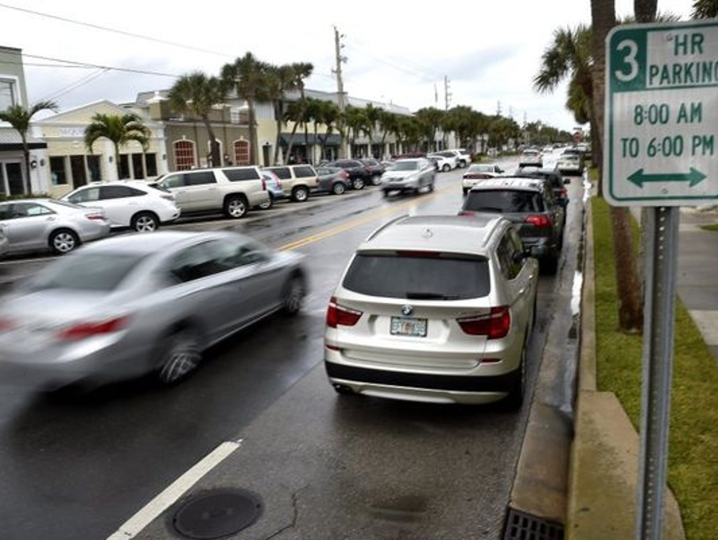Some businesses want the city to return to three-hour parking in the beachside business area.