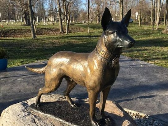 This bronze statue of a police dog keeps vigil at the Ohio Police K9 Memorial in Amelia,