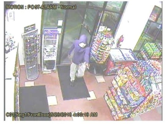 In this surveillance camera image, a man can be seen robbing the Duke and Duchess store on Union Street on May 29.