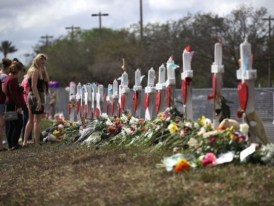 A makeshift memorial in front of Marjory Stoneman Douglas High School.