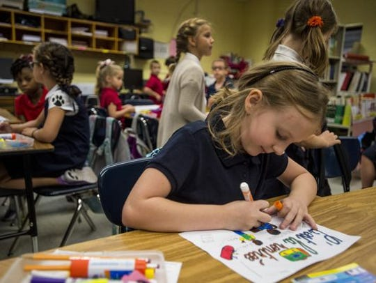 Students in a Lafayette Parish elementary school work