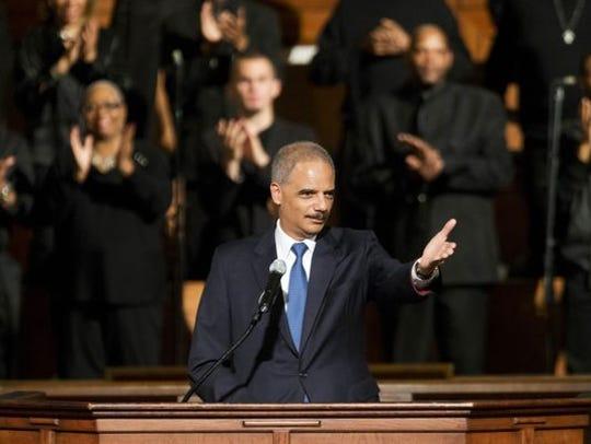 U.S. Attorney General Eric Holder gestures as he speaks