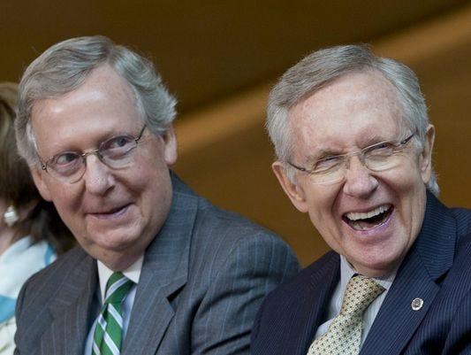 Senate Minority Leader Mitch McConnell, left, and Majority Leader Harry Reid share a laugh.