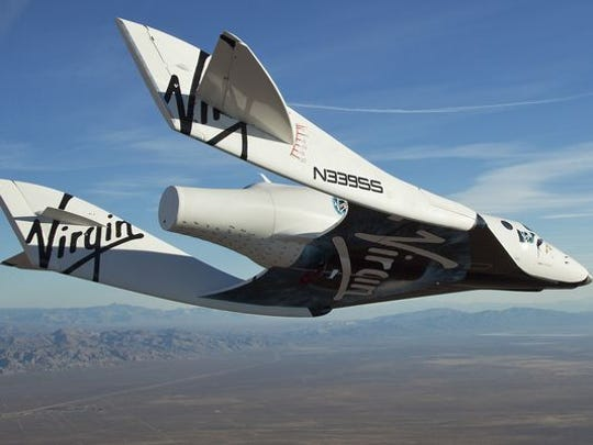 "The Virgin Galactic SpaceShipTwo ""VSS Enterprise"" glided toward the earth on its first test flight after release from the mothership, WhiteKnight2, also known as VMS Eve, over the Mojave, California, area on Oct. 10, 2010. (Photo: Mark Greenberg, Virgin Galactic, via AP)"