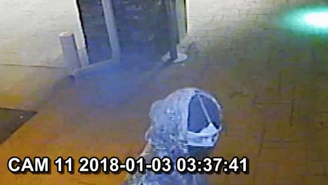 Pictured is one of the suspects entering the Holiday Inn early Wednesday during an armed robbery.