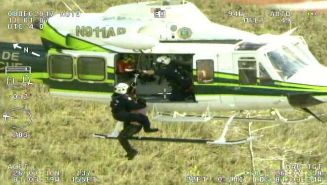 A Miami-Dade Fire Rescue helicopter rescues one of two hikers who were lost hiking the Florida Trail in the Everglades on Friday, Dec. 8, 2017.