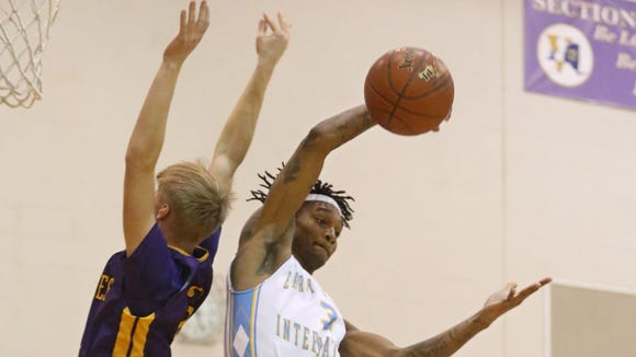Early College's Shandare Figgins pulls a rebound away