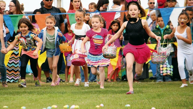 In this 2015 file photo children race to gather Easter Eggs during Alamogordo's annual Easter in the Park at Alameda Park. The 2016 event is March 26.