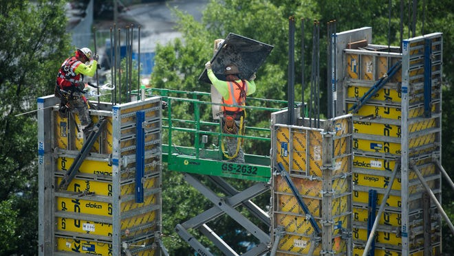 Construction on new apartments that border Falls Street is underway at the site of the Camperdown development in downtown Greenville.